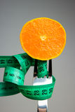 Orange fruit and measuring tape Royalty Free Stock Images