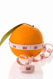Orange fruit and measuring tape Stock Photography