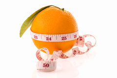 Orange fruit and measuring tape Stock Images