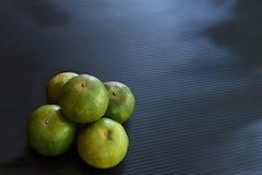 Orange fruit. The orange fruits with leathery , oily rind royalty free stock photo