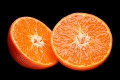 Orange fruit part on black Stock Images