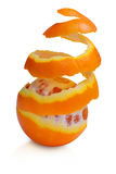 Orange fruit with peeled spiral skin Stock Photography