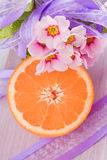 Orange fruit and pink blossom Stock Image