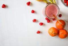 Orange Fruit And Raspberries Stock Photo