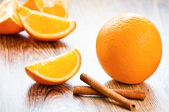 Orange fruit segment and cinnamon sticks Stock Photos