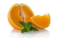 Orange fruit segment and mint leaf. On white background royalty free stock image