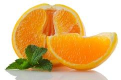 Orange fruit segment and mint leaf Stock Images