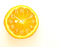 Orange fruit Slice Clock idea concept Stock Photo