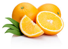 Orange fruit sliced with leaves  on white Stock Photography