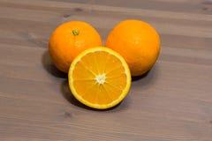 Orange fruit. Sliced  on wood background Stock Image