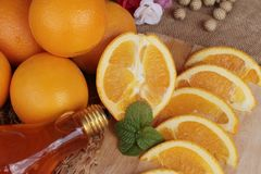 Orange fruit with slices and juice delicious. Royalty Free Stock Images