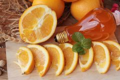 Orange fruit with slices and juice delicious. Stock Image