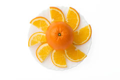 Orange fruit with slices on plate Stock Photo