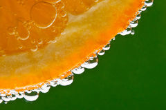 Orange fruit in sparkling water. Highlighted orange fruit in sparkling water Royalty Free Stock Photography