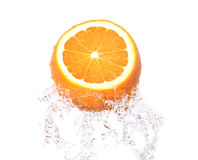Orange fruit in splash Royalty Free Stock Images