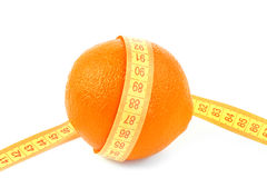 Orange fruit with tape measure Stock Images