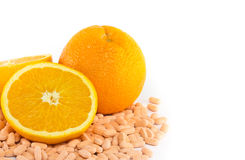 Orange fruit with vitamin c tablet. On white background Royalty Free Stock Photo