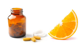 Orange fruit with vitamin c tablet and  bottle on the w Stock Photo