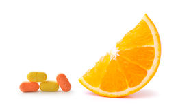 Orange fruit with vitamin c tablet Royalty Free Stock Images