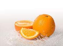 Orange fruit and water splash Royalty Free Stock Photos