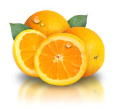 Orange Fruit on White background. Orange slices are on a white background and there are two leaves behind them. There are water drops for freshness of the fruit Stock Images