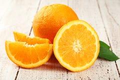 Orange fruit on white wooden background Stock Photos