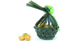 Orange fruit in wickerwork basket Stock Images
