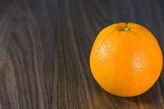 Orange fruit. Orange fruit on wooden background Royalty Free Stock Images