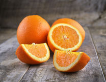 Orange fruit on wooden background Stock Image