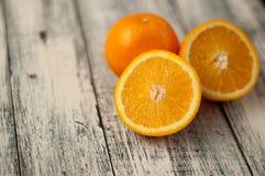 Orange fruit on wooden table background, close up, horizontal. Orange fruit on wooden background, close up, horizontal royalty free stock photo