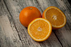 Orange fruit on wooden table background, close up, horizontal. Orange fruit on wooden background, close up, horizontal royalty free stock photography