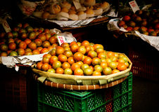 Orange fruits in basket for sale in urban market Stock Photos