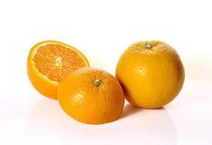 Orange fruits close up on background Stock Photo