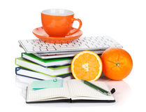 Orange fruits, coffee cup and office supplies Stock Photography