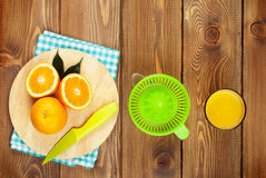 Orange fruits and glass of juice Royalty Free Stock Images