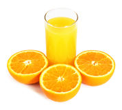 Orange fruits and glass of juice on white Stock Image