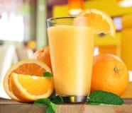 Orange fruits and glass of orange juice. Stock Photo