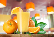 Orange fruits and glass of orange juice. Stock Photography