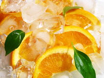 Orange fruits with ice cubes. On isolated  white background Stock Photos