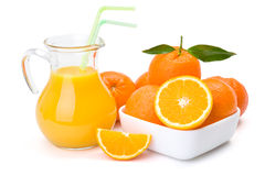 Orange fruits and jug of juice Royalty Free Stock Image