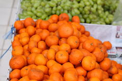 Orange fruits in the market Stock Images