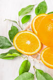 Orange fruits sliced with green leaves Stock Images