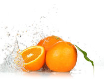 Orange fruits and Splashing water Royalty Free Stock Images