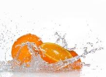 Orange fruits. And Splashing water Stock Photos
