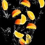 Orange fruits. And Splashing water Royalty Free Stock Images