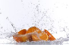Orange fruits and Splashing water Stock Images