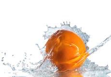 Orange fruits and Splashing Royalty Free Stock Photography