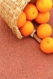 Orange fruits in wicker basket. Oranges fruits in wicker basket on Rubber floor Royalty Free Stock Image