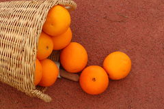 Orange fruits in wicker basket. Oranges fruits in wicker basket on Rubber floor Royalty Free Stock Photos