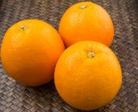 Orange Fruits On Wicker IX Stock Photography